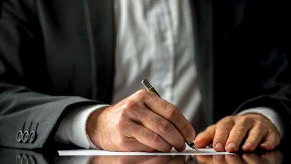 Professional person signing document