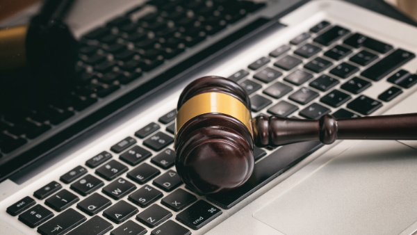 Photo showing a gavel and a laptop