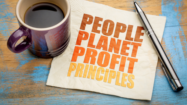 Triple bottom line principles: people planet profit written on serviette.