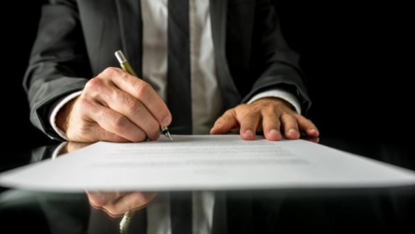 Man signing legal document