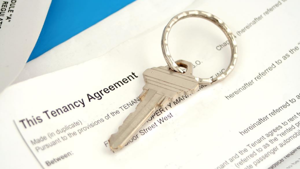 Tenancy agreement paperwork and a key