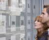 Couple looking in estate agent's window