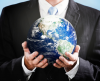 Business person holding globe in hands